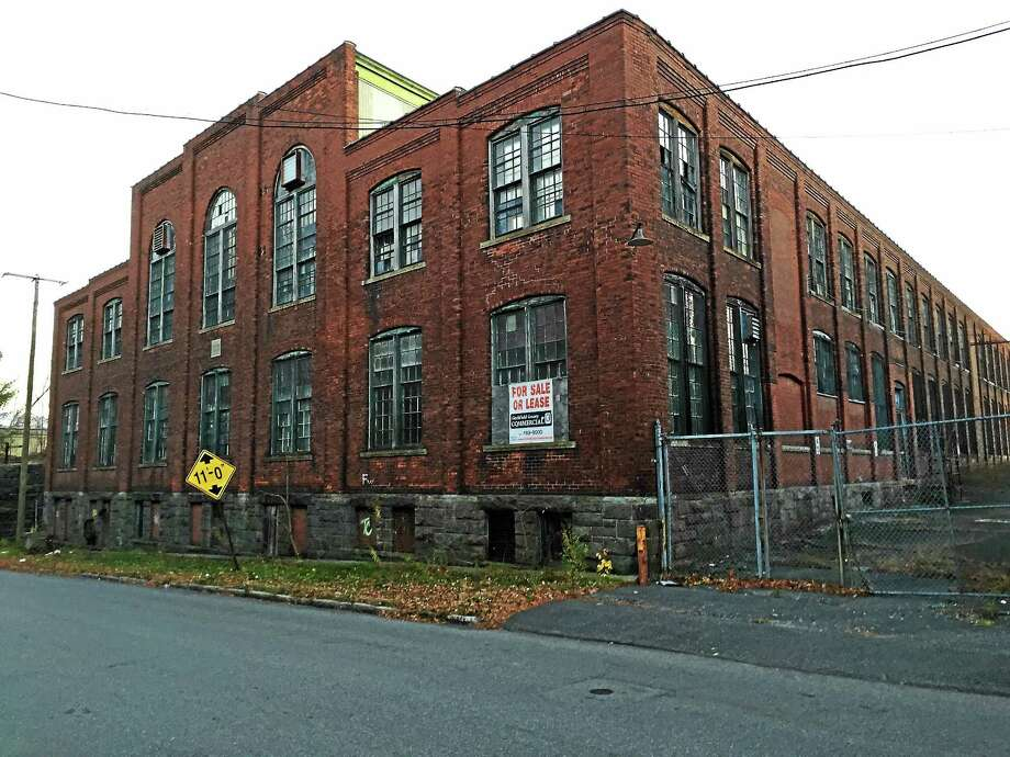 File photo - The Register Citizen  City officials approved a plan to further assess an empty industrial building like this one, using grant funding. Photo: Journal Register Co.