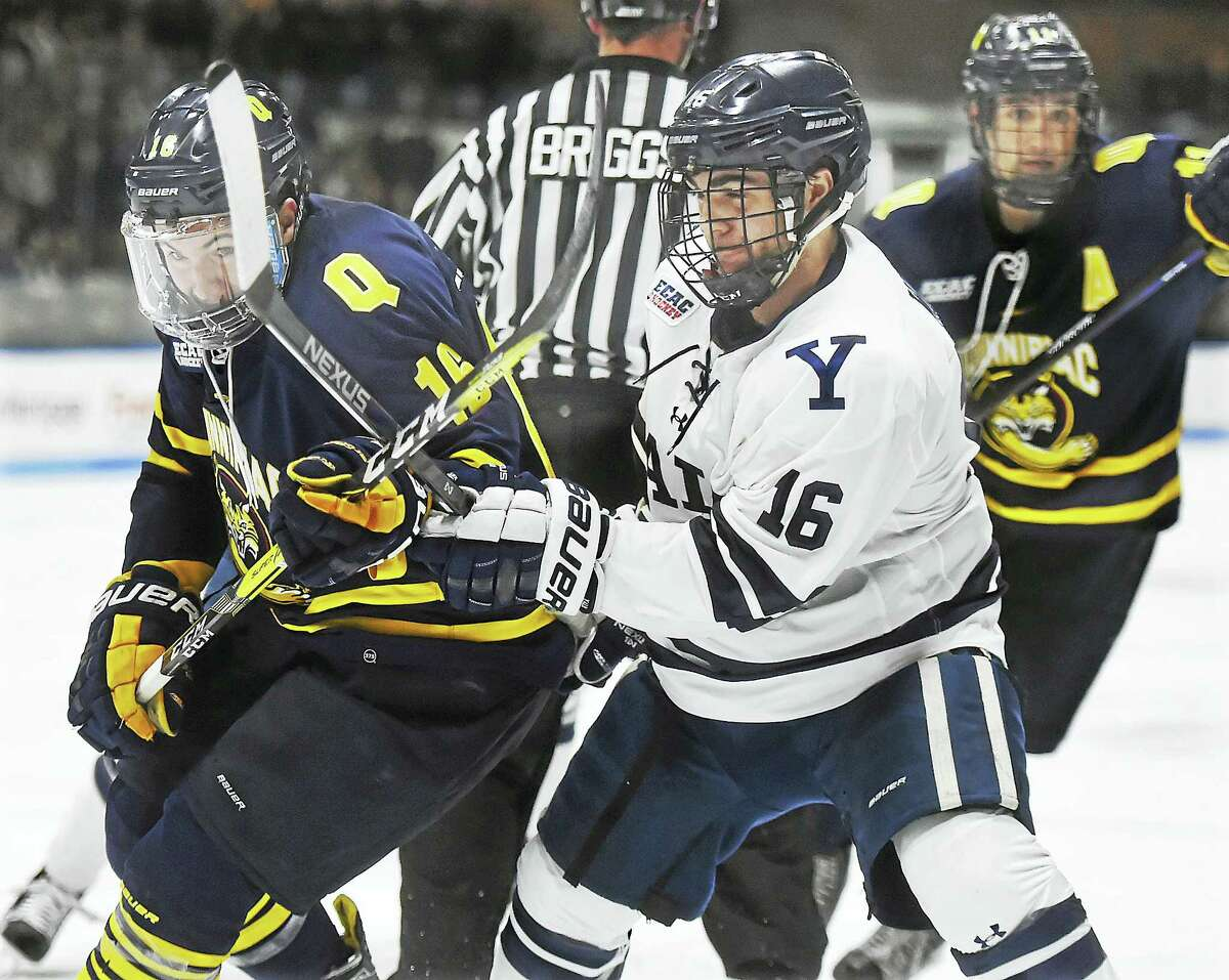 Quinnipiac's Landon Smith battles with Yale's Anthony Walsh during their game earlier this month.