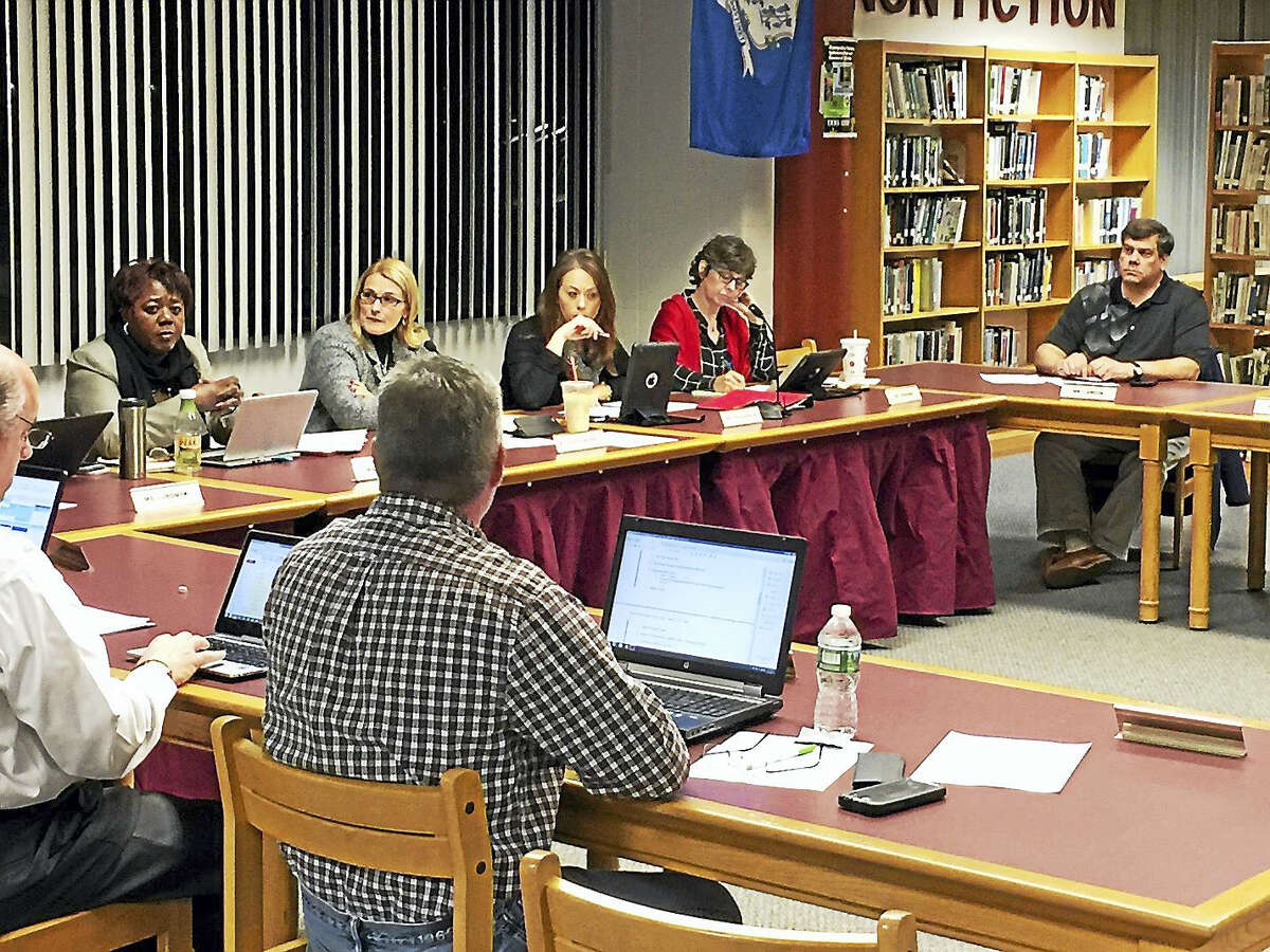 Ben Lambert - The Register Citizen The Torrington Board of Education discussed initial suggestions for the redistricting of city schools with Superintendent Denise Clemons, seated at the right, on Wednesday.