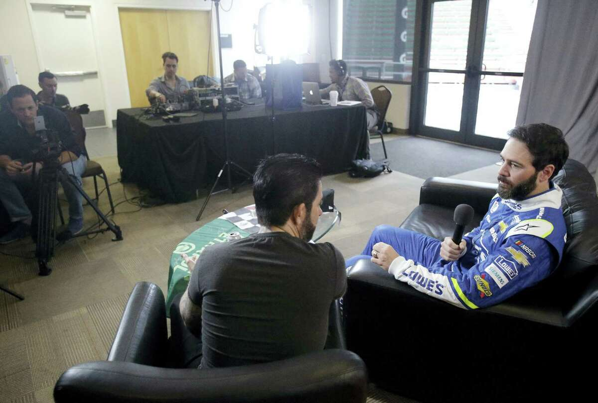 Jimmie Johnson, right, answers questions during an interview at NASCAR Daytona 500 media day at Daytona International Speedway on Feb. 22, 2017 in Daytona Beach, Fla.