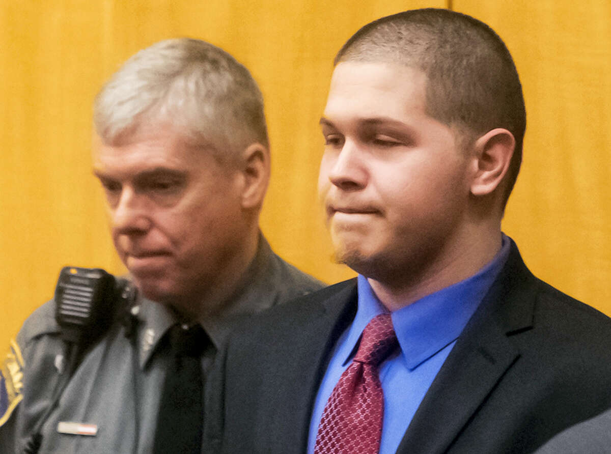 Tony Moreno, right, enters the courtroom during his murder trial Feb. 15 in Middletown.