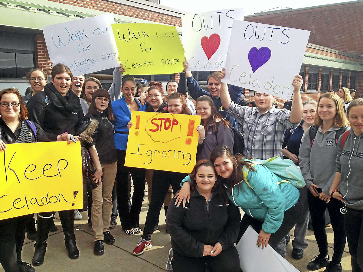Emily M. Olson - The Register CitizenOliver Wolcott Tech assistant principal Tanya Celadon, center, is joined by students on her last day at the school Wednesday. The students planned a peaceful protest to show their dismay over losing Celadon, who has been at the school for four years.