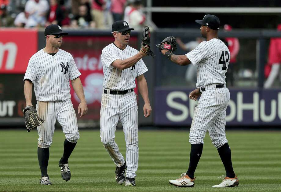 From left, the Yankees' Brett Gardner, Jacoby Ellsbury and Aaron Hicks celebrate after Saturday's win. Photo: Julie Jacobson — The Associated Press  / Copyright 2017 The Associated Press. All rights reserved.