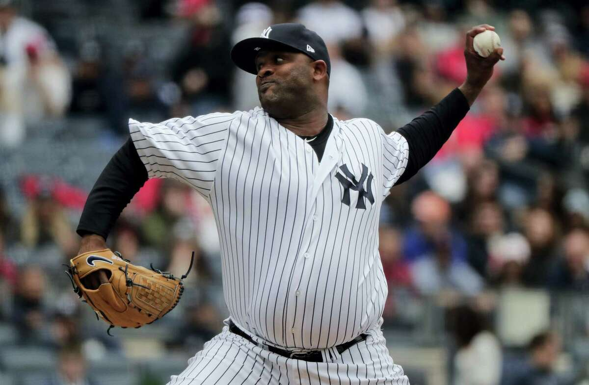 Yankees pitcher CC Sabathia delivers against the Cardinals in the second inning.