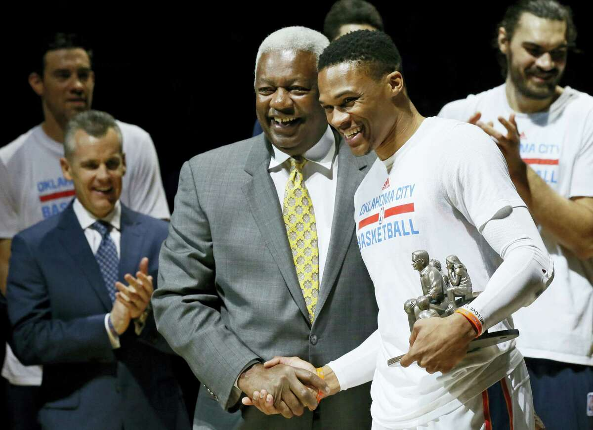 Oklahoma City Thunder guard Russell Westbrook, right, is congratulated by Oscar Robertson on his triple-double record before the Thunder's game on Wednesday.
