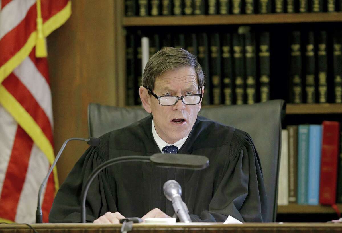 Judge Jeffrey Locke asks the jury a question at the start of the sixth day of jury deliberations.