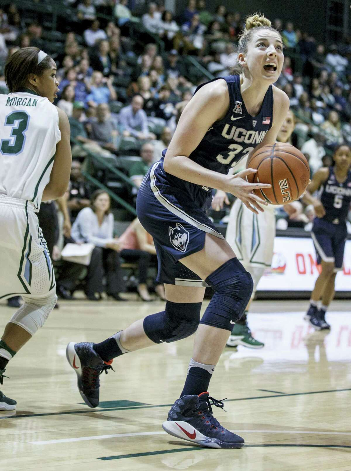 UConn guard/forward Katie Lou Samuelson (33) goes to the basket during the first half of the Huskies' win over Tulane Saturday.