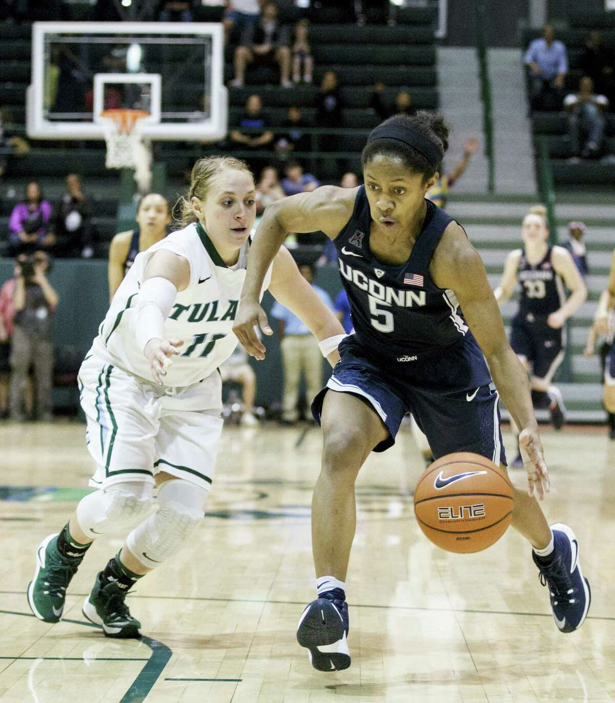 Tulane guard Leslie Vorpahl runs after UConn guard Crystal Dangerfield during the second half of the Huskies' victory Saturday against Tulane.