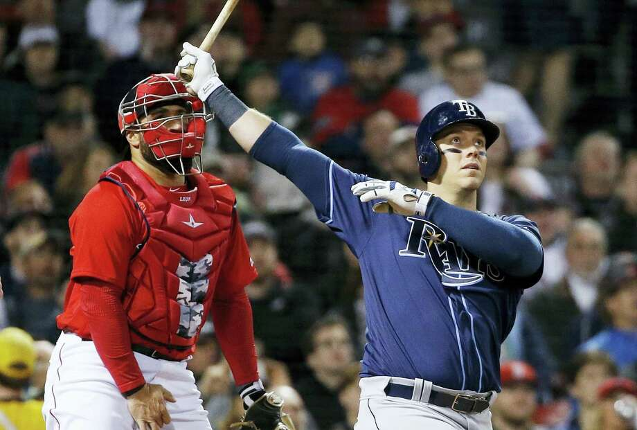 The Rays' Logan Morrison, right, watches his grand slam in the third inning Friday. Photo: Michael Dwyer — The Associated Press  / Copyright 2017 The Associated Press. All rights reserved.