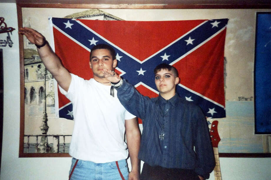 This undated photo provided by Christian Picciolini shows him at left with Shannon Martinez giving Nazi salutes while both were affiliated with racist skinhead organizations as young people decades ago. Picciolini went on to begin Life After Hate, a nonprofit that works to get people out of extremist groups, and Martinez volunteers by talking to people in an online forum sponsored by the organization. Photo: Alex Picciolini/Courtesy Of Christian Picciolini Via AP  / Christian Picciolini