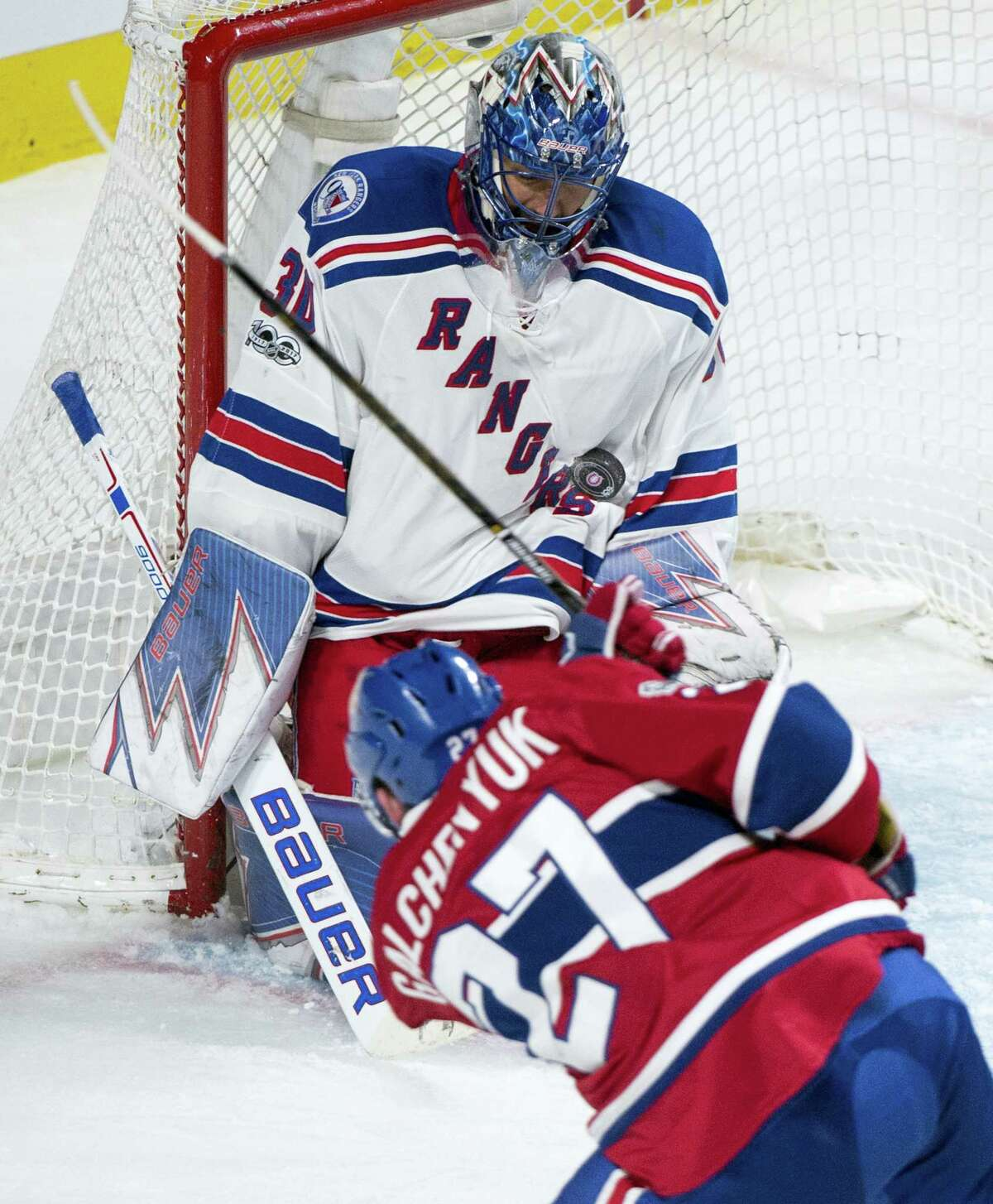 Rangers goaltender Henrik Lundqvist stops a shot by the Canadiens' Alex Galchenyuk during the second period Friday in Montreal.