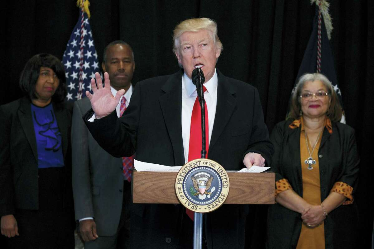 President Donald Trump speaks at the National Museum of African American History and Culture, Tuesday, Feb. 21, 2017, in Washington. Also Tuesday, Trump's Department of Homeland Security laid out its revised plan to enforce immigration law and detain or deport the undocumented.