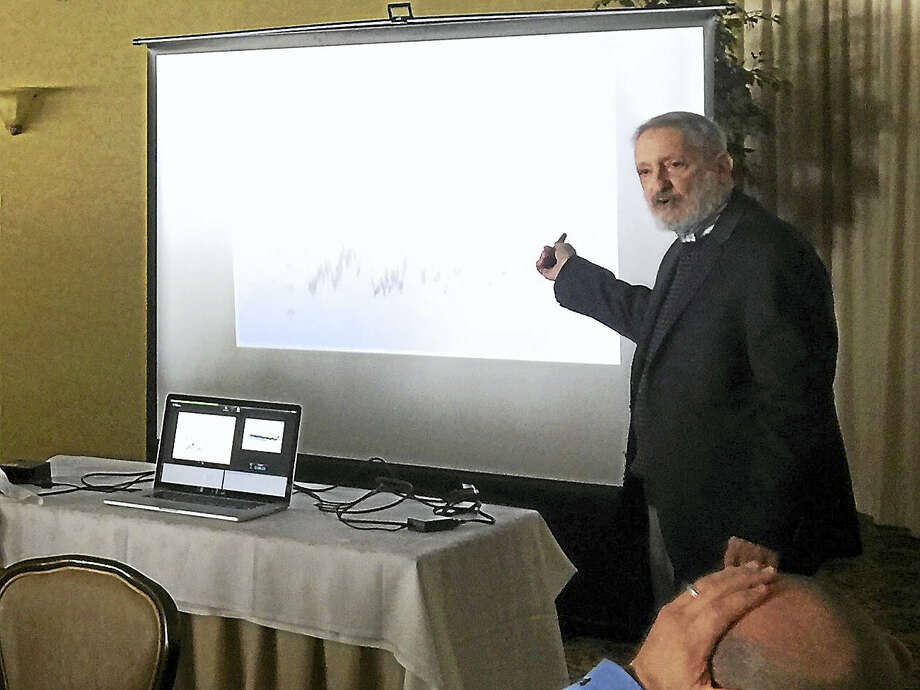 Ben Lambert - The Register CitizenDr. James Barrante shares his view on the cause of global warming with the Torrington-Winsted Area Rotary Club Tuesday. Photo: Digital First Media
