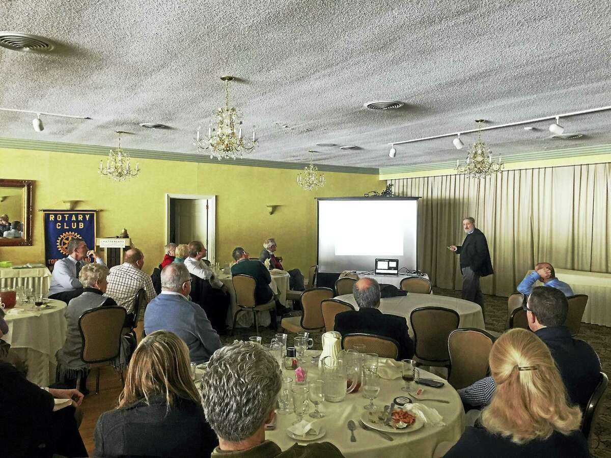 Ben Lambert - The Register CitizenDr. James Barrante shares his view on the cause of global warming with the Torrington-Winsted Area Rotary Club Tuesday.