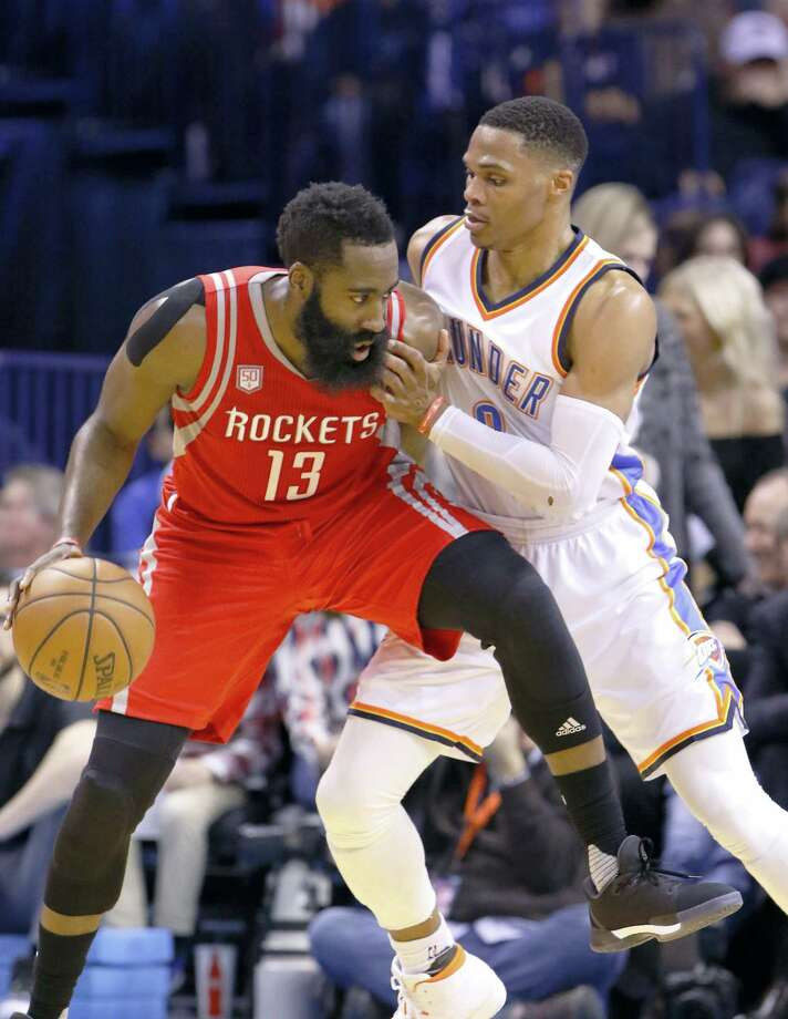 MVP candidates James Harden, left, and Russell Westbrook will square off against each other in the playoffs. Photo: The Associated Press File Photo  / FR159426 AP
