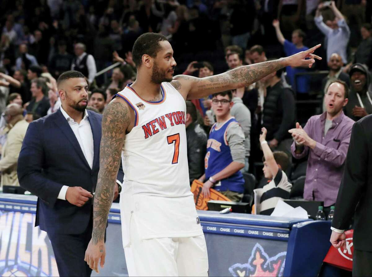 The Knicks' Carmelo Anthony gestures to fans after a game this season.