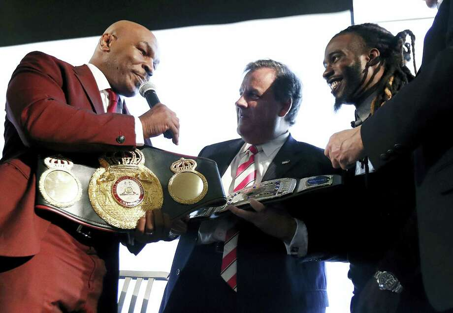 New Jersey Gov. Chris Christie, center, is presented with a belt by boxer Mike Tyson, left, for Christie's work in promoting help for ex-prisoners re-entering society. Photo: Julio Cortez — The Associated Press  / Copyright 2017 The Associated Press. All rights reserved.