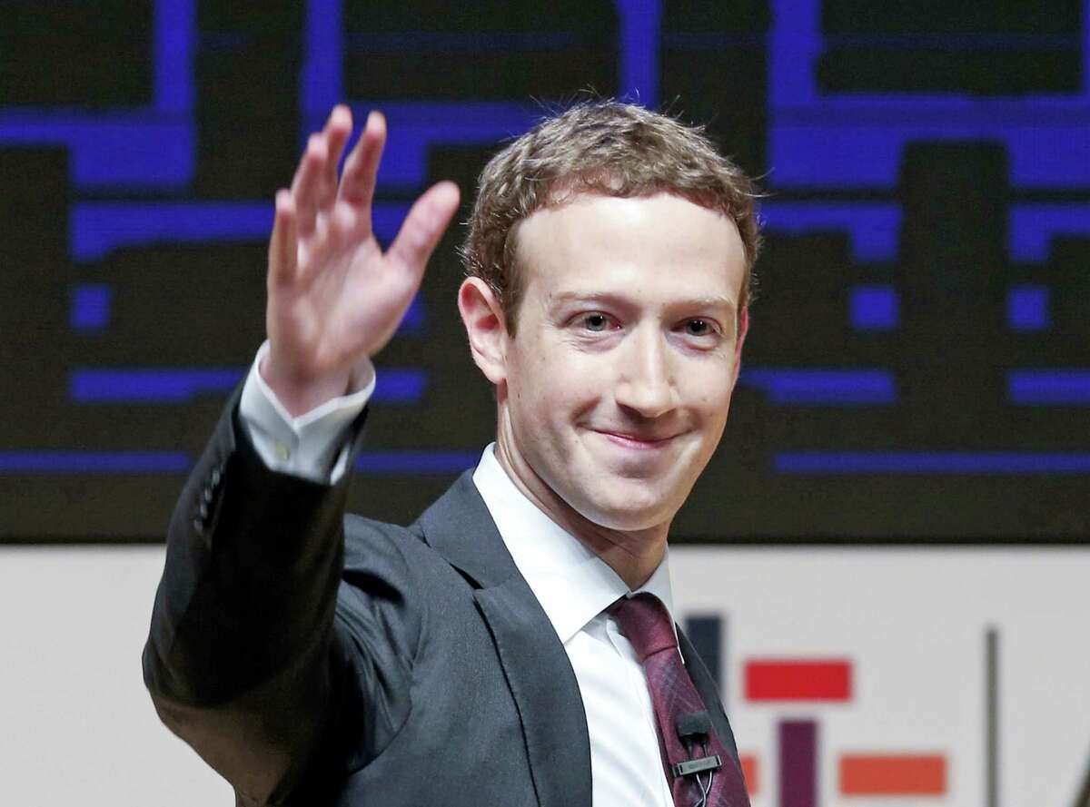 In this Nov. 19, 2016 photo, Mark Zuckerberg, chairman and CEO of Facebook, waves at the CEO summit during the annual Asia Pacific Economic Cooperation (APEC) forum in Lima, Peru. Zuckerberg released a missive Thursday, Feb. 16, 2017, outlining his vision for the social network and the world at large. Among other things, Zuckerberg hopes that the social network can encourage more civic engagement, an informed public and community support in the years to come.