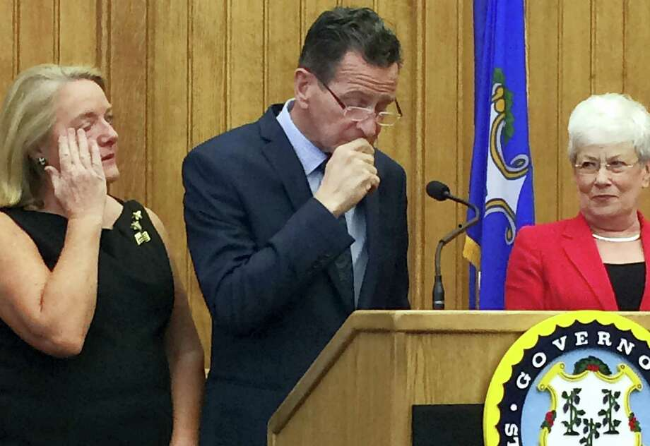 Connecticut Gov. Dannel P. Malloy pauses after announcing Thursday, April 13, 2017, at the Capitol in Hartford, Conn., that he will not seek a third term in 2018. He is flanked by his wife, Cathy, left, and Lt. Gov. Nancy Wyman, right. (AP Photo/Susan Haigh) Photo: AP / Copyright 2017 The Associated Press. All rights reserved.