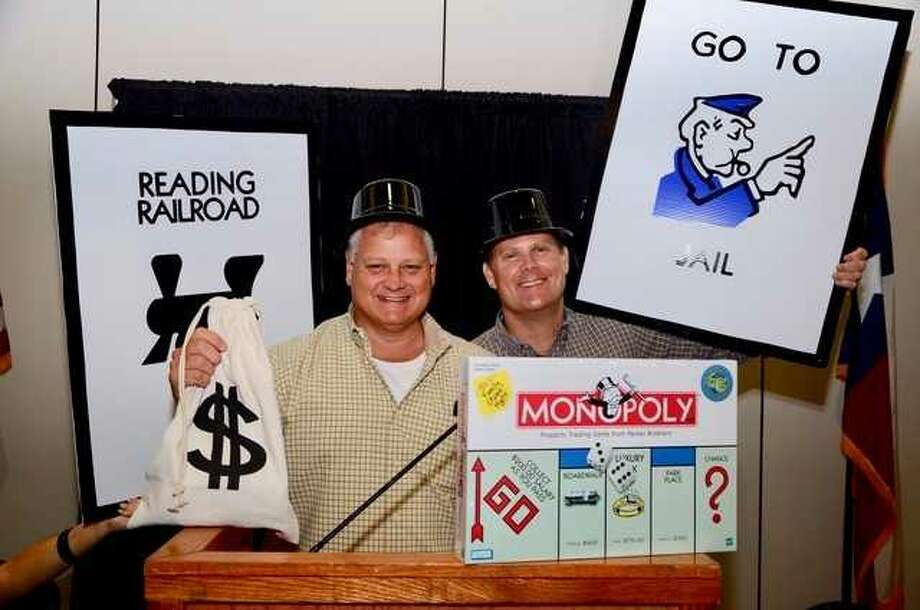 Conroe Noon Lions Club Vice Presidents Scott Perry & Bobby Brennan are reminding everyone about the 'Lion-opoly' themed annual Dinner/Dance & Auction fundraiser coming up on Thursday, Sept. 7th. Deadline for ticket sales is Friday, Sept. 1st contact 936/760-1666 for more information. Photo: Submitted Photo