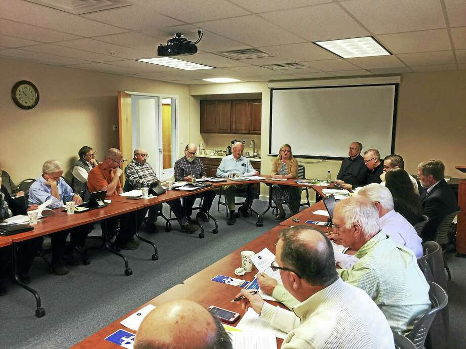 Members of the Northwest Hills Council of Governments discussed legislative priorities and state-level budgeting with Betsy Gara, executive director of the Connecticut Council of Small Towns, Thursday in Goshen. Photo: Ben Lambert — The Register Citizen