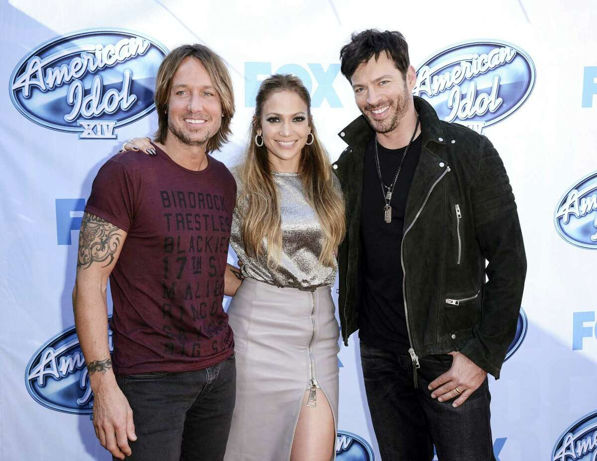 """From left to right, singer Keith Urban, singer and actress Jennifer Lopez, and singer Harry Connick, Jr. arrive on set of """"American Idol"""" in Los Angeles."""