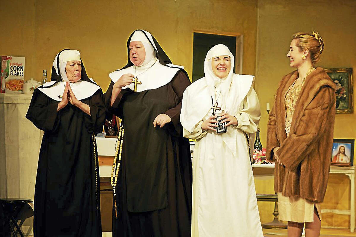 """Judy Sullivan as the Second Nun, Blythe Everett as the Head Nun, Jessica Gleason as The Little Nun and Erin Shaughnessy in """"The House of Blue Leaves."""""""