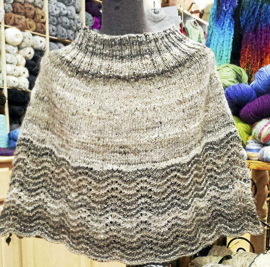 A lace-edged cape made by a friend of Ginger Balch is on display at her shop, In Sheep's Clothing in Torrington. Photo: Contributed Photo