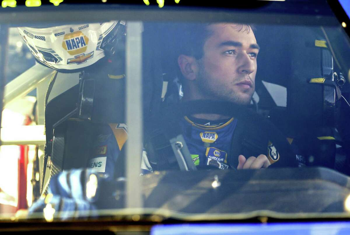 Chase Elliott prepares to exit his car after his first qualifying run on Sunday.