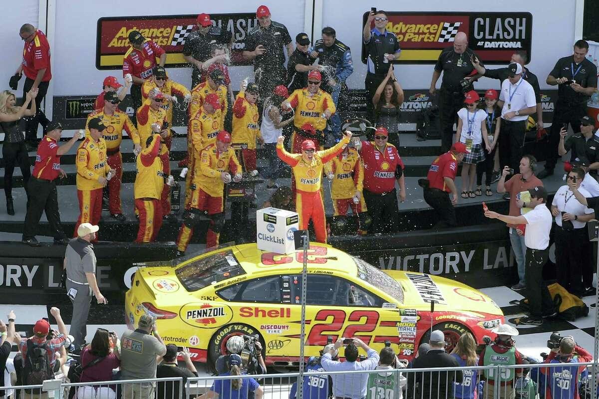 Joey Logano celebrates in Victory Lane after winning the NASCAR Clash at Daytona on Sunday.
