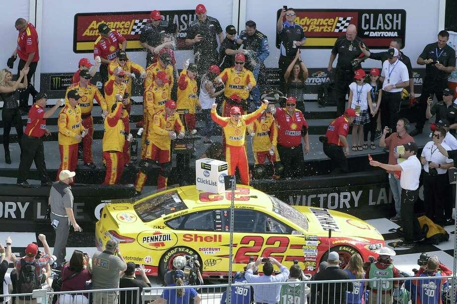 Joey Logano celebrates in Victory Lane after winning the NASCAR Clash at Daytona on Sunday. Photo: Phelan M. Ebenhack — The Associated Press  / FR121174 AP