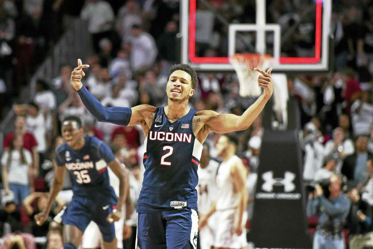 UConn's Jalen Adams gestures to the crowd after hitting the game-winning shot against Temple on Sunday.