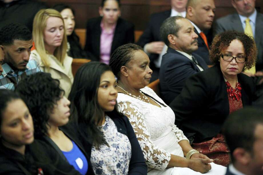 Family and friends of Daniel de Abreu and Safiro Furtado listen to the judge speak to the jury in defendant Aaron Hernandez's trial at Suffolk Superior Court, Tuesday, April 11, 2017, in Boston. Hernandez is on trial for the July 2012 killings of Daniel de Abreu and Safiro Furtado who he encountered in a Boston nightclub. The former New England Patriots NFL player is already serving a life sentence in the 2013 killing of semi-professional football player Odin Lloyd. Photo: AP Photo/Elise Amendola, Pool   / Pool, AP
