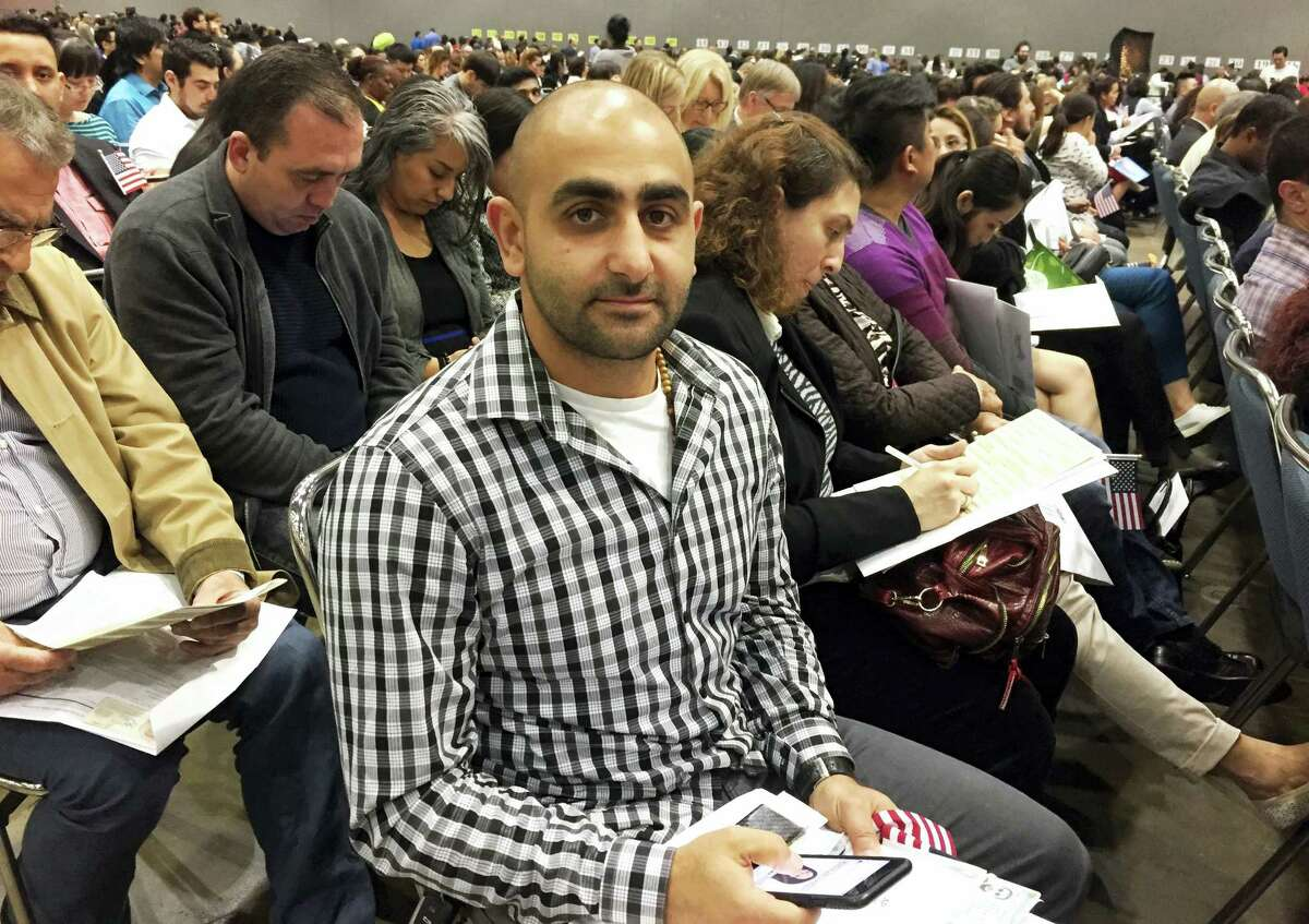 """In this Feb. 15, 2017 photo, Nareg Fradjian, of Pasadena, Calif., poses at a Los Angeles ceremony where he became a U.S. citizen. He said that while most people like Presidents Day for the sales, """"It's awesome to have that one designated day just to say 'Thank you.' """""""