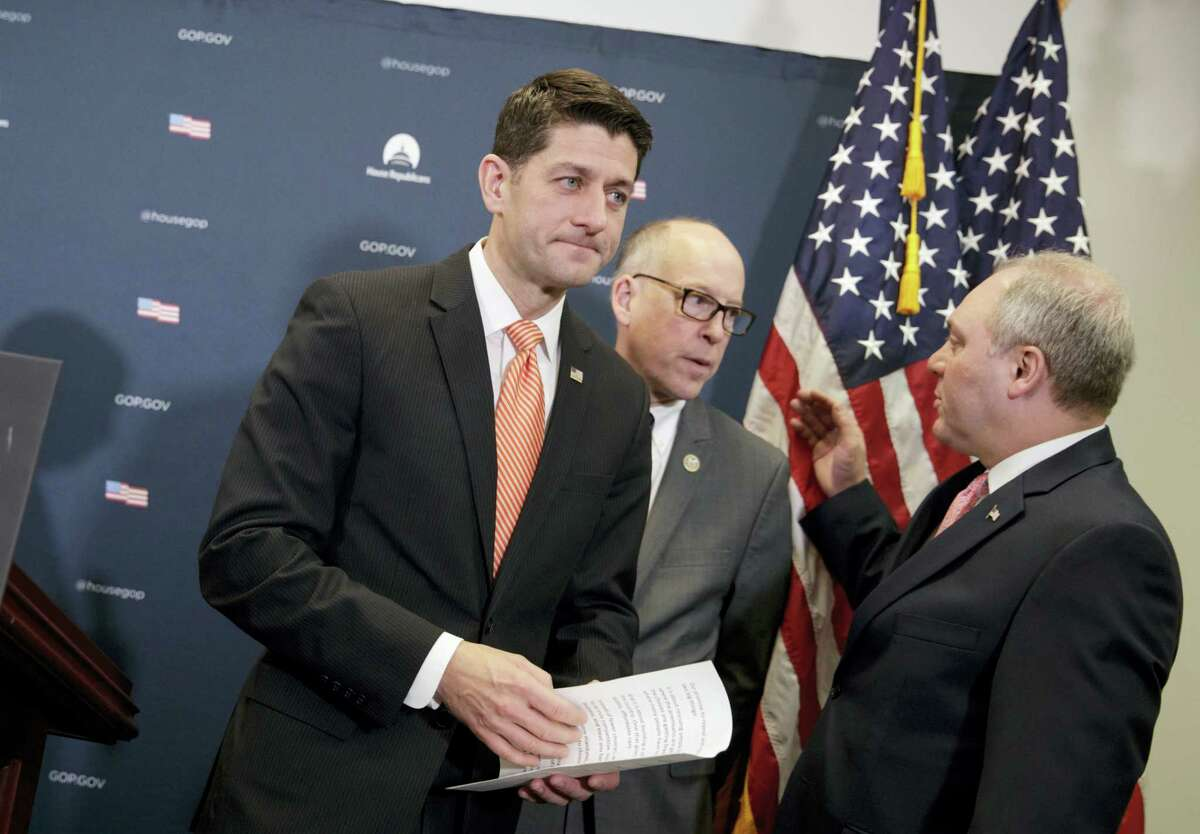 House Speaker Paul Ryan of Wis., joined by House Majority Whip Steve Scalise of La., right, and Rep. Greg Walden, R-Ore., departs a news conference after responding to reporters about the ouster of Michael Flynn, President Trump's national security adviser, Tuesday, Feb. 14, 2017, on Capitol Hill in Washington.