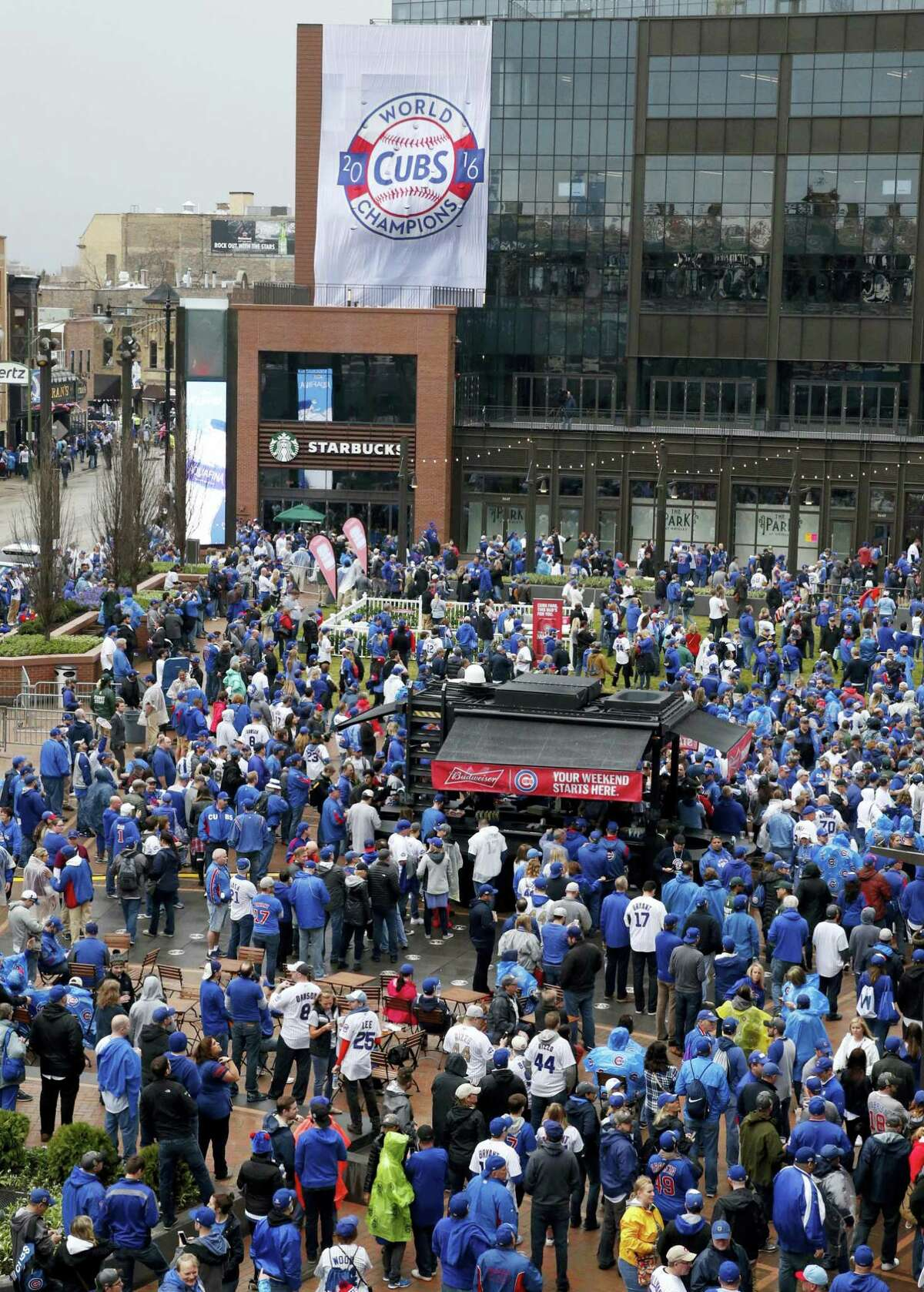 Fans gather outside in the Park at Wrigley before a baseball game between the Chicago Cubs and the Los Angeles Dodgers on home opening day April 10, 2017 in Chicago.