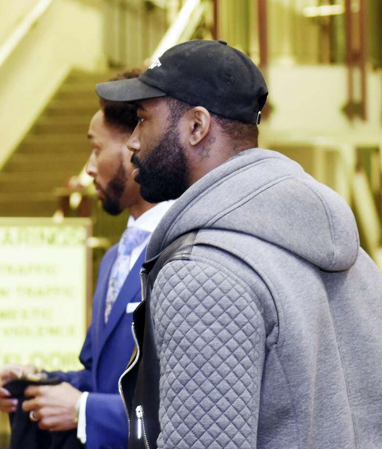 New York Jets cornerback Darrelle Revis, right, enters the Pittsburgh Municipal Courts Building on Friday. Photo: John Heller — Post-Gazette Via AP  / Pittsburgh Post-Gazette
