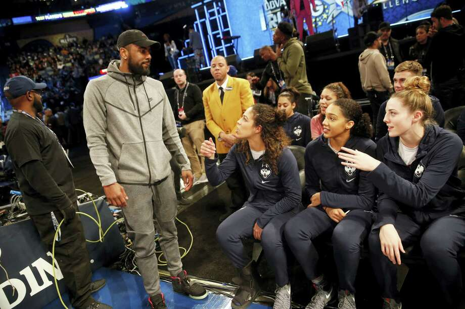 The Cavaliers' Kyrie Irvin greets members of the UConn women's basketball team during the Rising Stars Challenge in New Orleans on Friday. Photo: The Associated Press  / Copyright 2017 The Associated Press. All rights reserved.