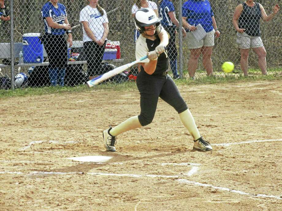 Thomaston's Alexa Milius is about to connect for her second home run of the game in a victory over Lewis Mills Tuesday. Photo: Peter Wallace - Register-Citizen