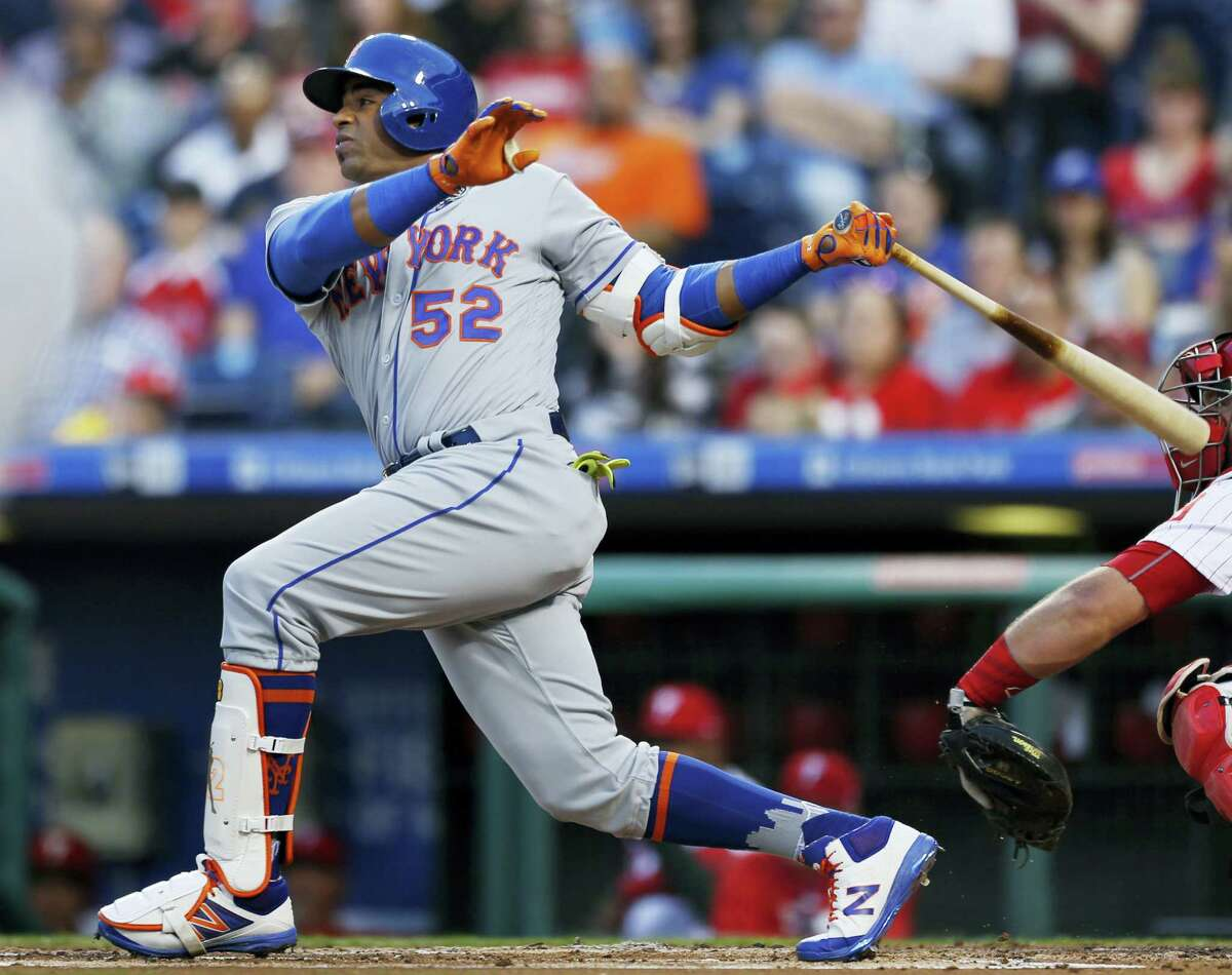 New York Mets' Yoenis Cespedes follows through on a three-run home run off Philadelphia Phillies starting pitcher Clay Buchholz during the first inning of a baseball game, Tuesday, April 11, 2017, in Philadelphia. (AP Photo/Laurence Kesterson)