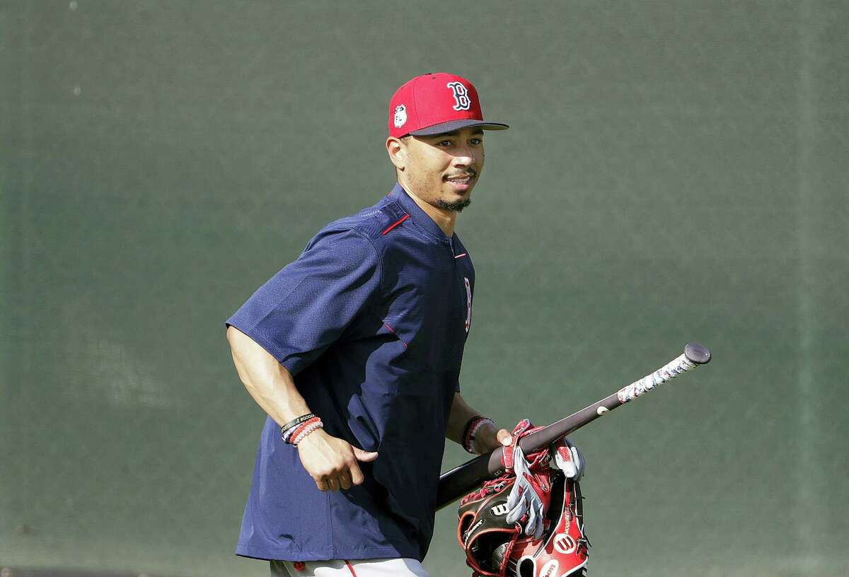 Mookie Betts runs to the field for a workout in Fort Myers, Fla., earlier this week.