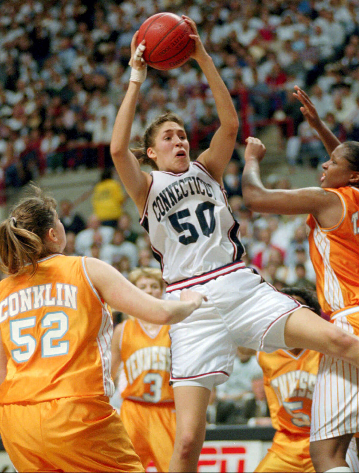 UConn's Rebecca Lobo (50) pulls in a rebound against Tennessee during a 1995 game.