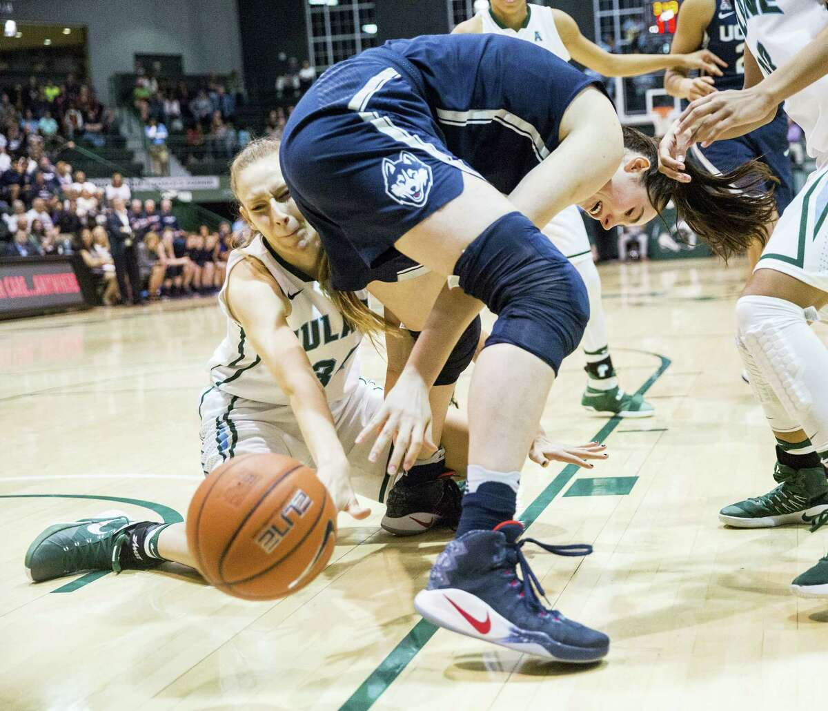 Tulane center Ksenija Madzarevic, left, tries to get the ball from UConn's Natalie Butler.