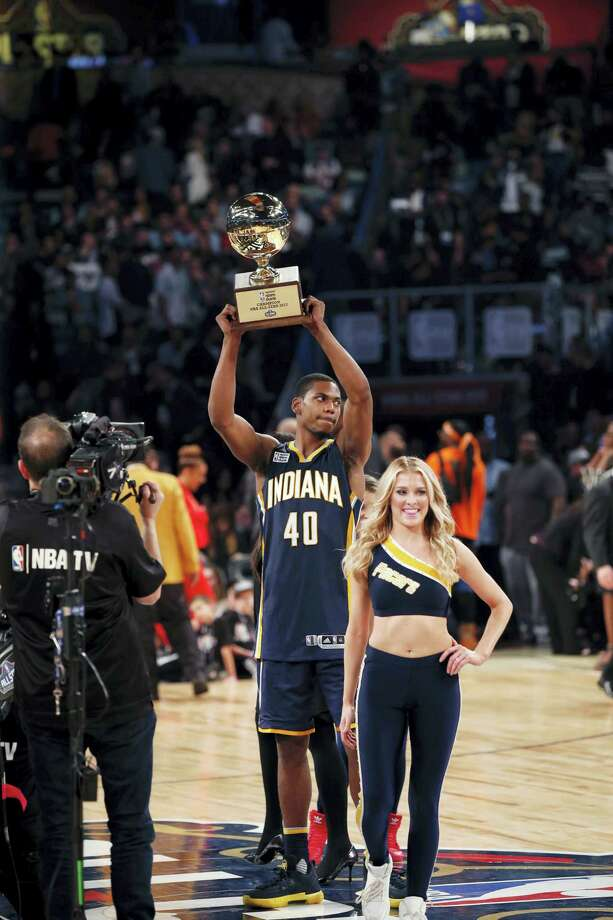 Indiana pacers Glenn Robinson III holds up his trophy after winning the slam dunk contest during NBA All-Star Saturday Night events in New Orleans, Saturday, Feb. 18, 2017. (AP Photo/Gerald Herbert) Photo: AP / Copyright 2017 The Associated Press. All rights reserved.