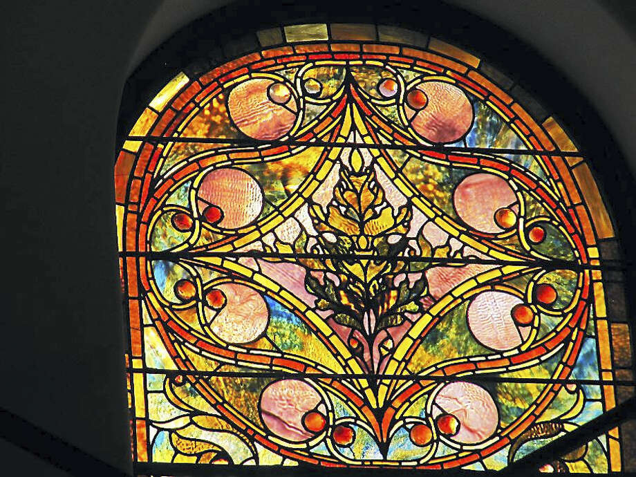 A newly restored stained glass window at the Battell Chapel in Norfolk is part of an ongoing restoration project being conducted by Glass Source Stained Glass Studio in Shelton. Photo: Contributed Photo