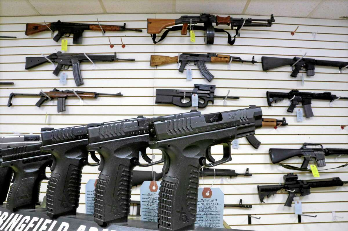 In this Jan. 16, 2013, photo, weapons are seen for sale at Capitol City Arms Supply in Springfield, Ill.
