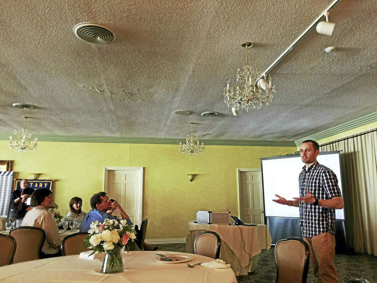 Noah Cass, a Marine who served two tours in Iraq and found long-distance running helped him in his return to civilian life, shared his story with the Torrington-Winsted Rotary Club Tuesday.