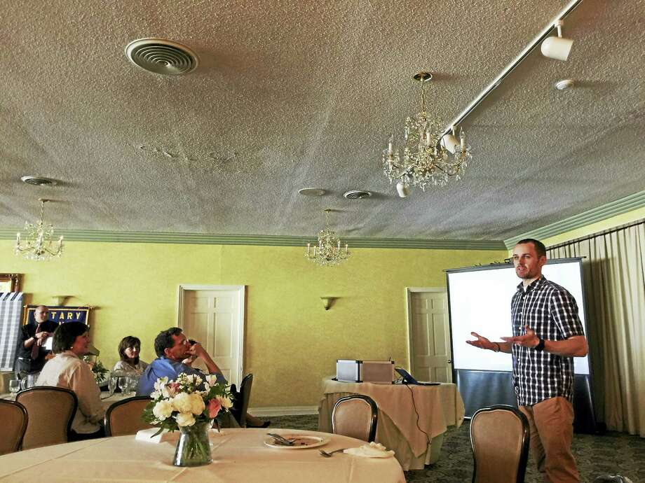 Noah Cass, a Marine who served two tours in Iraq and found long-distance running helped him in his return to civilian life, shared his story with the Torrington-Winsted Rotary Club Tuesday. Photo: Ben Lambert — The Register Citizen