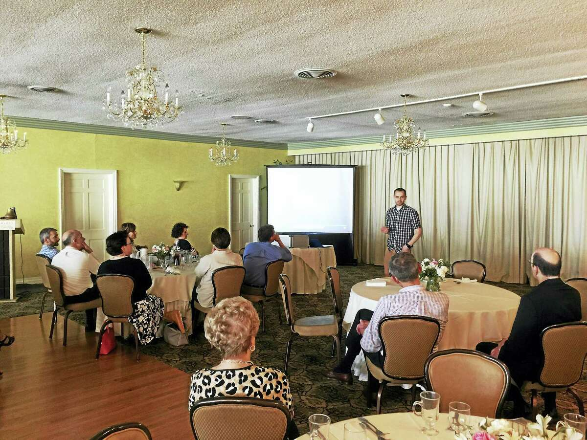 Members of the Torrington-Winsted Rotary Club listen to Noah Cass during his talk on Tuesday.