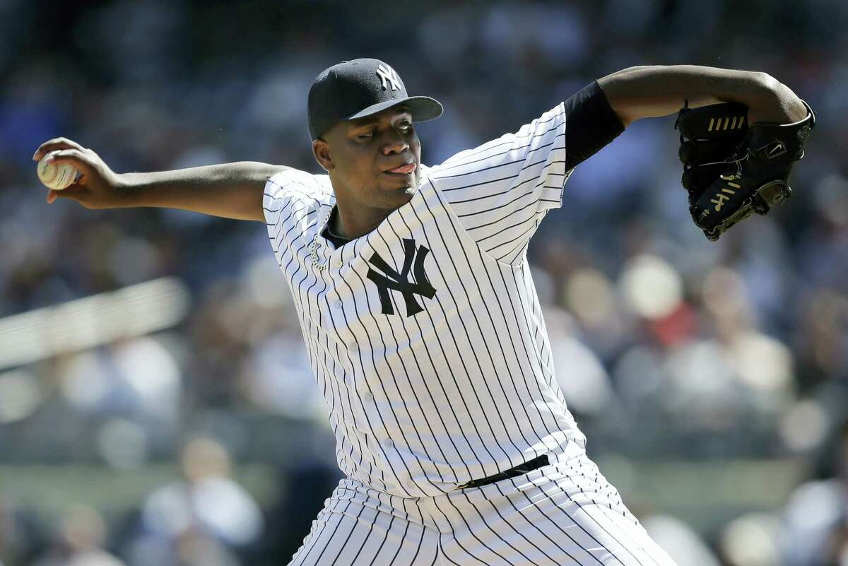 New York Yankees starting pitcher Michael Pineda throws during the second inning against the Tampa Bay Rays at Yankee Stadium, Monday. Pineda took a perfect game into the seventh inning in the Yankees' 8-1 win.
